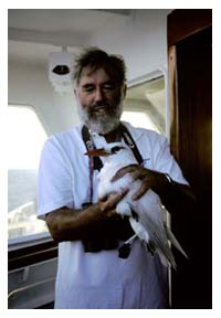 Dr Cameron Kepler Holds A Red-tailed Tropicbird